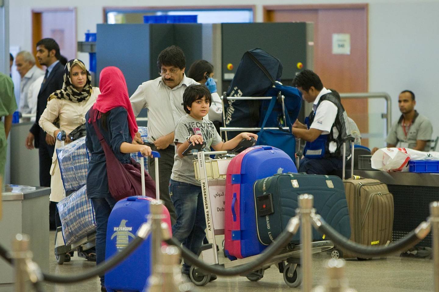 United Arab Emirates - Dubai - August 2, 2010.BUSINESS: Travelers go through a security check point at Dubai International Airport Terminal 2 in Dubai on Monday, August 2, 2010. Amy Leang/The National