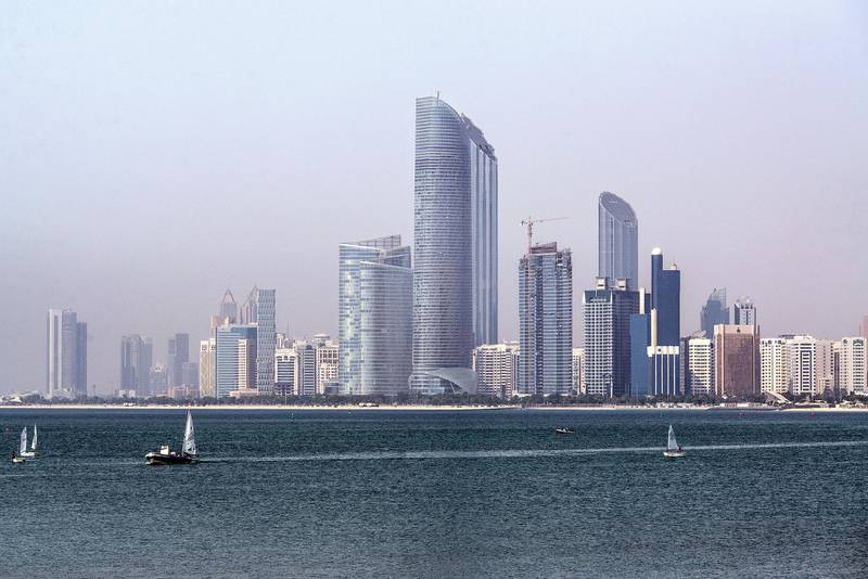 The Landmark skyscraper, center, stands on the city skyline beside a waterway in Abu Dhabi, United Arab Emirates, on Monday, May 30, 2016. Abu Dhabi, which sits on six percent of global oil reserves, cut spending by a fifth in 2015 and plans a further 17 percent reduction this year, according to the governments bond prospectus. Photographer: Alex Atack/Bloomberg