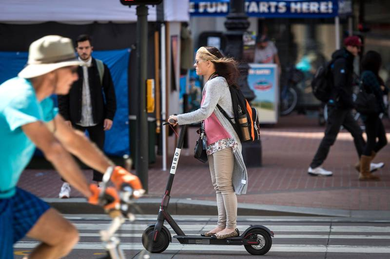 A person rides a Bird Rides Inc. shared electric scooter in San Francisco, California, U.S., on Friday, April 13, 2018. GPS-enabledscootersand bicycles are spreading across several major U.S. cities, driven by a wave of venture capital into a handful of companies.Policymakers are scrambling to find ways to regulate thegreat scooter boom of 2018. Photographer: David Paul Morris/Bloomberg