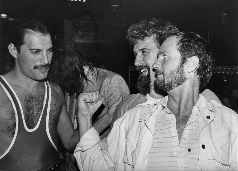 From left to right, singer Freddie Mercury (1946 - 1991) of British rock band Queen with comedian Billy Connolly and DJ Kenny Everett, during Mercury's 38th birthday party at the Xenon nightclub, 1984. (Photo by Dave Hogan/Getty Images)