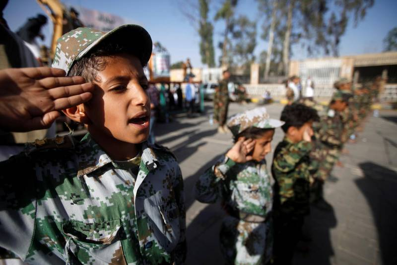 A boy salutes the flag as he and supporters of the Houthi movement attend a rally to celebrate following claims of military advances by the group near the borders with Saudi Arabia, in Sanaa, Yemen October 4, 2019. REUTERS/Mohamed al-Sayaghi