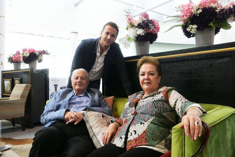 DUBAI, UNITED ARAB EMIRATES , November 11 – 2020 :- Mansour Cheikh El Ard, owner of Granny's Waffles with his parents at the Dubai Mall in Dubai. He let his tenant to stay rent-free in a villa. Social media post on this caught people's attention and public is trying to support the business. They are getting an increased number of orders. He is from Syria and living in Dubai since 2005. (Pawan Singh / The National) For News/Online/Instagram. Story by Anam