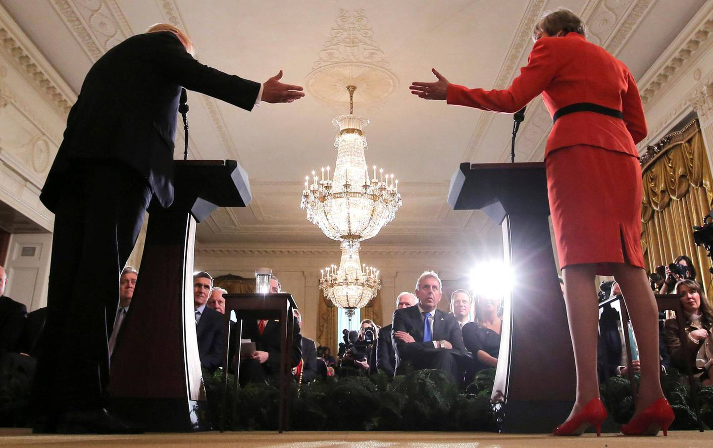 FILE PHOTO: Britain's ambassador to the United States Kim Darroch (C) listens as U.S. President Donald Trump and British Prime Minister Theresa May hold a joint news conference at the White House in Washington, U.S., January 27, 2017.  Picture taken January 27, 2017. REUTERS/Carlos Barria/File Photo
