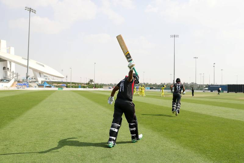 Abu Dhabi, United Arab Emirates - October 22, 2018: Ashfaq Ahmed of the UAE comes out to bat in the match between the UAE and Australia in a T20 international. Monday, October 22nd, 2018 at Zayed cricket stadium oval, Abu Dhabi. Chris Whiteoak / The National