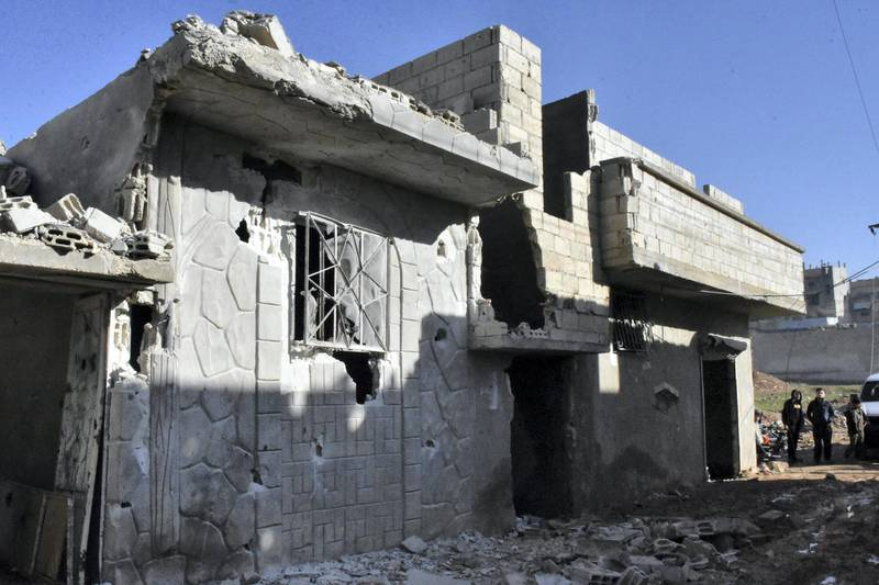 """A handout picture released by the official Syrian Arab News Agency (SANA) on January 22, 2021, shows a building damaged by reported Israeli strikes on the Syrian province of Hama. - The Syrian Observatory for Human Rights said the Israeli raids targeted Syrian military sites and resulted in the """"destruction"""" of five of them in an area of Hama where Iran-backed fighters are present. But the war monitor said the civilians were killed by """"debris from one of the Syrian anti-aircraft defence missiles that fell on a house in a densely populated neighbourhood"""". (Photo by STRINGER / SANA / AFP) / == RESTRICTED TO EDITORIAL USE - MANDATORY CREDIT """"AFP PHOTO / HO / SANA"""" - NO MARKETING NO ADVERTISING CAMPAIGNS - DISTRIBUTED AS A SERVICE TO CLIENTS =="""