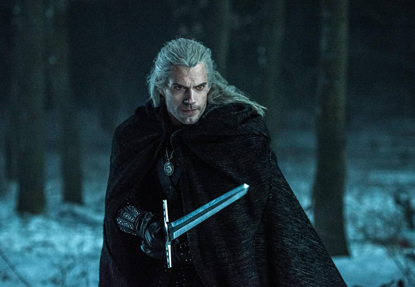 """This image released by Netflix shows Henry Caville in a scene from the series """"The Witcher,"""" based on a fantasy novel series that found fame as a video game.   (Katalin Vermes/Netflix via AP)"""