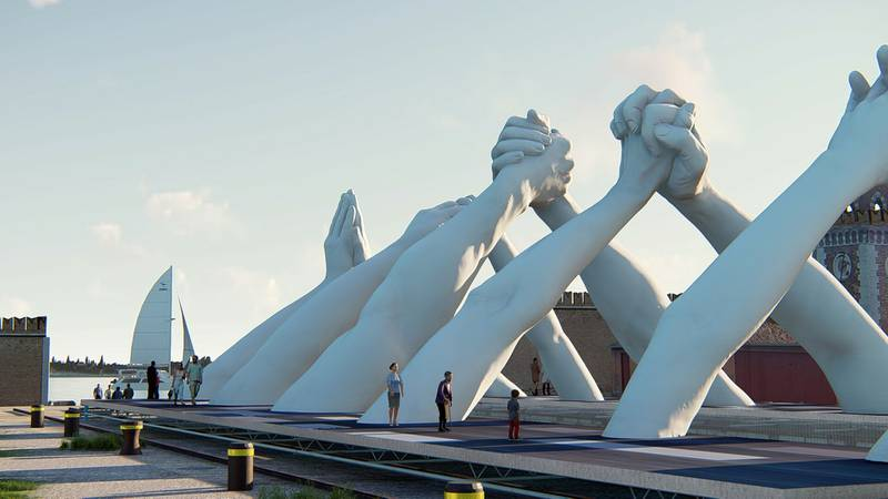 An artistic rendering of Lorenzo Quinn's six pairs of arching hands creating a bridge over a Venetian waterway. Italian artist Lorenzo Quinn created a splash on the sidelines of the Venice Biennale contemporary art fair two years ago with a sculpture of gigantic child's hands reaching out of the Grand Canal, calling attention to climate change that threatens, among other things, to sink the lagoon city. This edition, Quinn has created a successor sculpture that he wants to be a call to action: Six pairs of arching hands creating a bridge over a Venetian waterway, symbolic of the need overcome divisions. (BLJ via AP)
