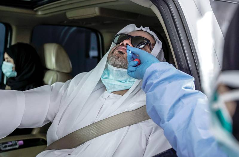 Dubai, United Arab Emirates, April 12, 2020.  A drive-through patient gets tested for the Coronavirus at the National Screening Center, Mina Rashed, Dubai.Victor Besa / The NationalSection:  NAReporter:  Nick Webster