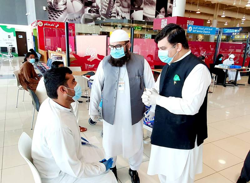 Pakistan consul-general Ahmed Ali at the Dubai International Airport during one of the repatriation flights on May 15. Courtesy: Pakistan Consulate