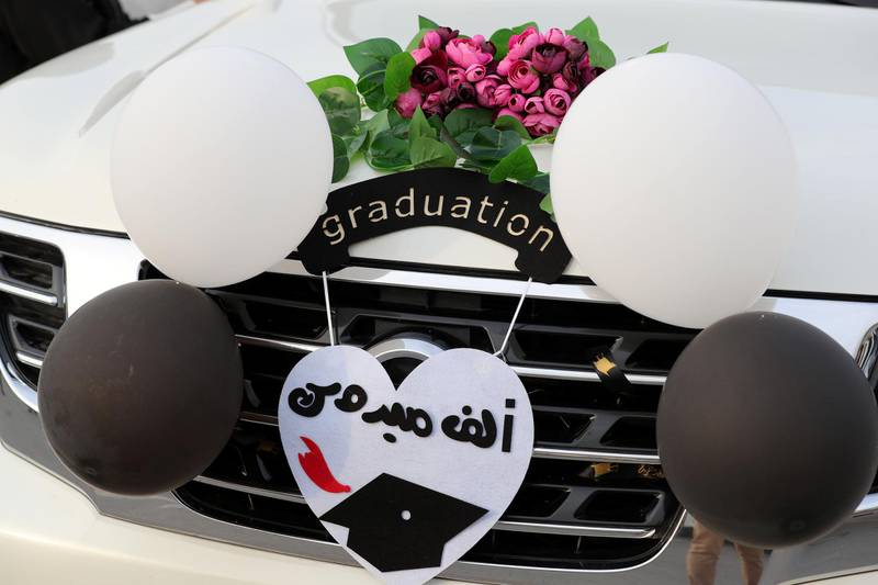 Ajman, United Arab Emirates - Reporter: Anam Rizvi. News. People attach balloons to their cars before the drive through graduation from Ajman University because of Covid-19. Wednesday, February 10th, 2021. Ajman. Chris Whiteoak / The National