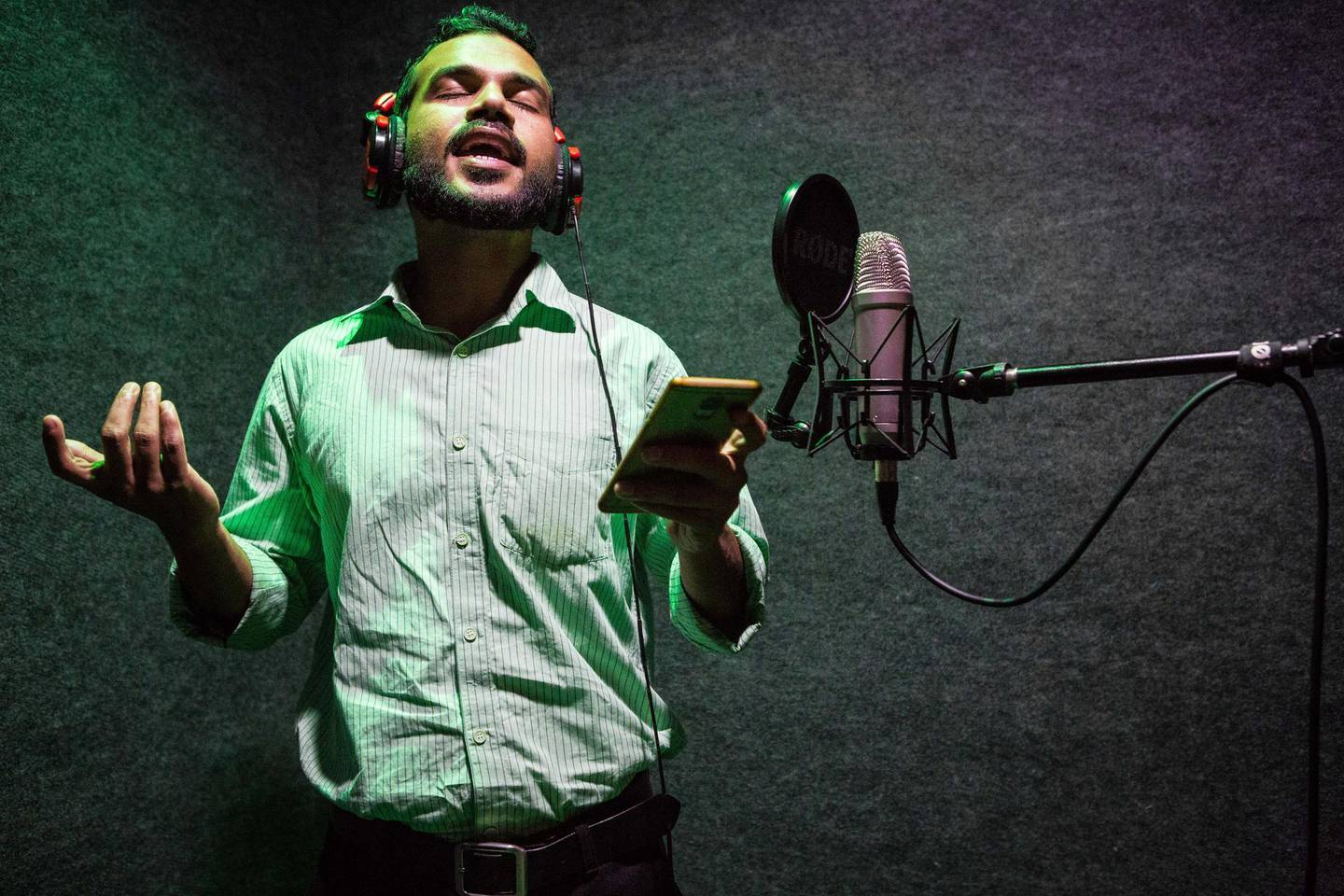 Singer Mohammed Aslam, 31, records a Kathu Pattu song at a musical studio located in Mampuram, Kerala, India. Photo by Sebastian Castelier