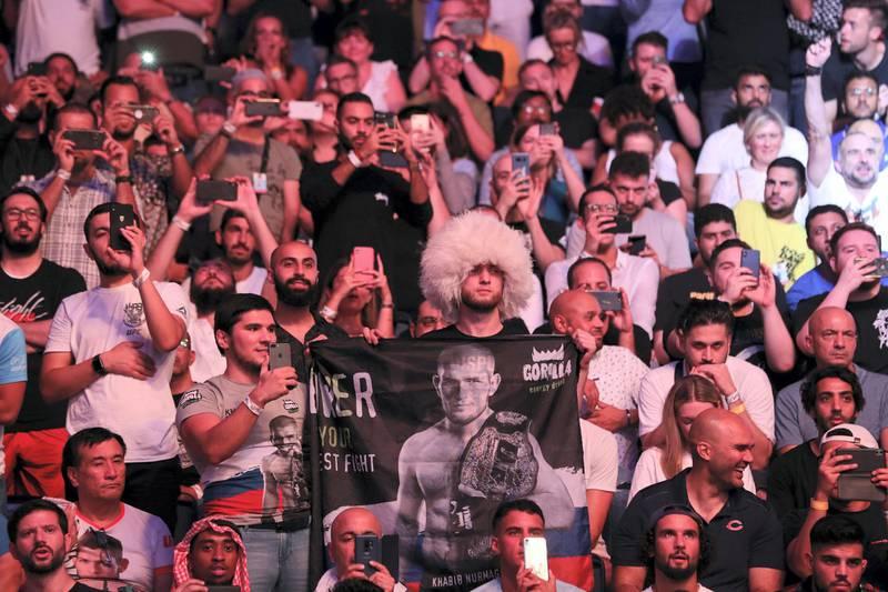 Abu Dhabi, United Arab Emirates - September 07, 2019: Lightweight title bout between Khabib Nurmagomedov (black shorts, winner) and Dustin Poirier in the main event at UFC 242. Saturday the 7th of September 2019. Yas Island, Abu Dhabi. Chris Whiteoak / The National