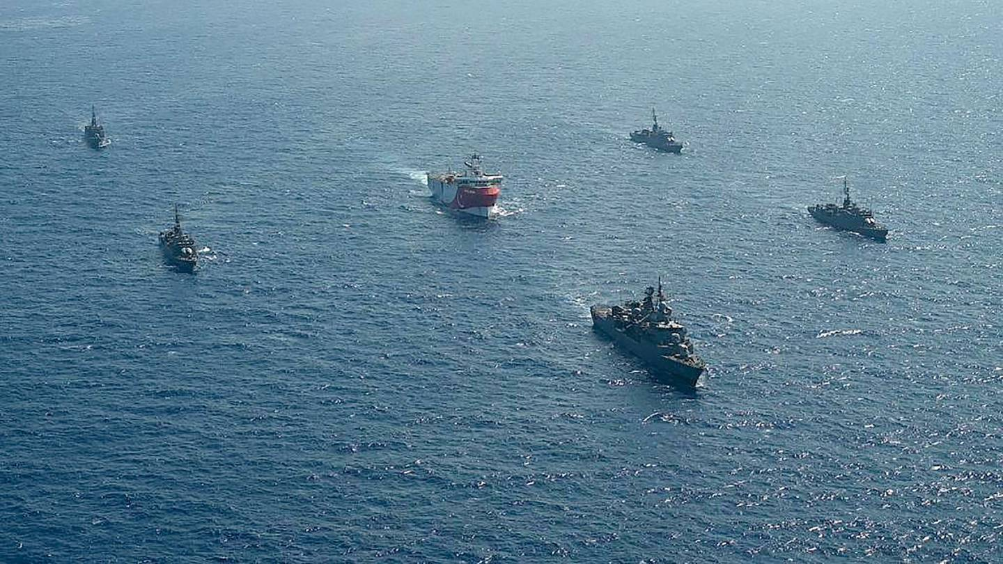 """This handout photograph released by the Turkish Defence Ministry on August 12, 2020, shows Turkish seismic research vessel 'Oruc Reis' (C) as it is escorted by Turkish Naval ships in the Mediterranean Sea, off Antalya on August 10, 2020.  Greece on August 11, demanded that Turkey withdraw a research ship at the heart of their growing dispute over maritime rights and warned it would defend its sovereignty, calling for an emergency meeting of EU foreign ministers to resolve the crisis. Tensions were stoked August 10, when Ankara dispatched the research ship Oruc Reis accompanied by Turkish naval vessels off the Greek island of Kastellorizo in the eastern Mediterranean.  - RESTRICTED TO EDITORIAL USE - MANDATORY CREDIT """"AFP PHOTO /TURKISH DEFENCE MINISTRY """" - NO MARKETING - NO ADVERTISING CAMPAIGNS - DISTRIBUTED AS A SERVICE TO CLIENTS  / AFP / TURKISH DEFENCE MINISTRY / - / RESTRICTED TO EDITORIAL USE - MANDATORY CREDIT """"AFP PHOTO /TURKISH DEFENCE MINISTRY """" - NO MARKETING - NO ADVERTISING CAMPAIGNS - DISTRIBUTED AS A SERVICE TO CLIENTS"""