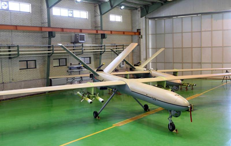 """A picture released on September 27, 2013 by the official website of Iran's Revolutionary Guards shows a newly Iranian-made drone, """"Shahed 129"""" (Witness 129) being shown in Tehran. Iran's Revolutionary Guards Commander, Major General Mohammad Ali Jafari announced that his forces have built a new type of military drone with missile and bombing capabilities, their latest achievement in the area of Unmanned Aerial Vehicles (UAVs) production. AFP PHOTO/HO/SEPAH NEWS   +++   RESTRICTED TO EDITORIAL USE - MANDATORY CREDIT """" AFP PHOTO / """"SEPAH NEWS"""" NO MARKETING NO ADVERTISING CAMPAIGNS - DISTRIBUTED AS A SERVICE TO CLIENTS   +++      EDS NOTE: AFP IS USING PICTURES FROM ALTERNATIVE SOURCES AS IT WAS NOT AUTHORISED TO COVER THIS EVENT, THEREFORE IT IS NOT RESPONSIBLE FOR ANY DIGITAL ALTERATIONS TO THE PICTURE'S EDITORIAL CONTENT, DATE AND LOCATION WHICH CANNOT BE INDEPENDENTLY VERIFIED == (Photo by HO / SEPAH NEWS / AFP)"""