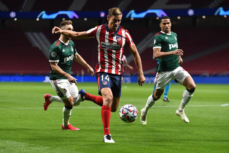 MADRID, SPAIN - NOVEMBER 25: Marcos Llorente of Atletico de Madrid shoots during the UEFA Champions League Group A stage match between Atletico Madrid and Lokomotiv Moskva at Estadio Wanda Metropolitano on November 25, 2020 in Madrid, Spain. Football Stadiums around Europe remain empty due to the Coronavirus Pandemic as Government social distancing laws prohibit fans inside venues resulting in fixtures being played behind closed doors. (Photo by Denis Doyle/Getty Images)