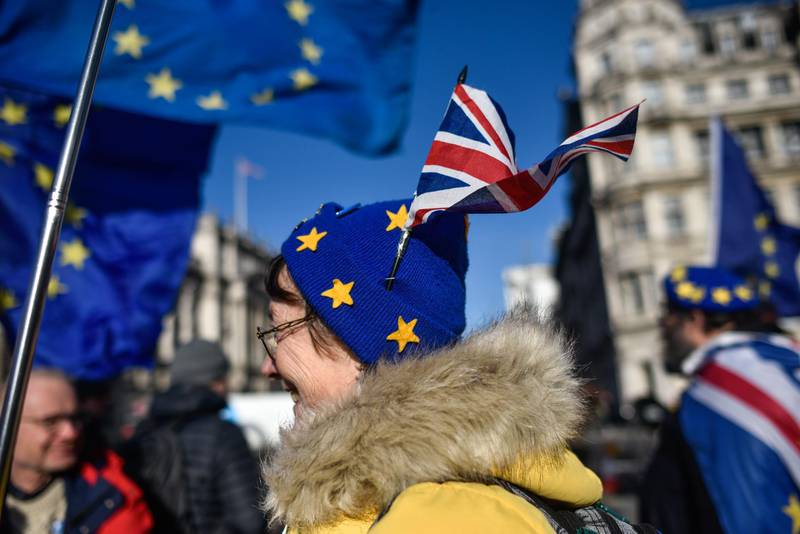 LONDON, ENGLAND - JANUARY 01: A pro-EU activist wears a Union Jack in her EU styled hat while protesting outside the Houses of Parliament on January 1, 2020 in London, England. The UK is due to leave the European Union this Friday, Jan 31st, after Britons voted to leave in the 2016 referendum. (Photo by Peter Summers/Getty Images)
