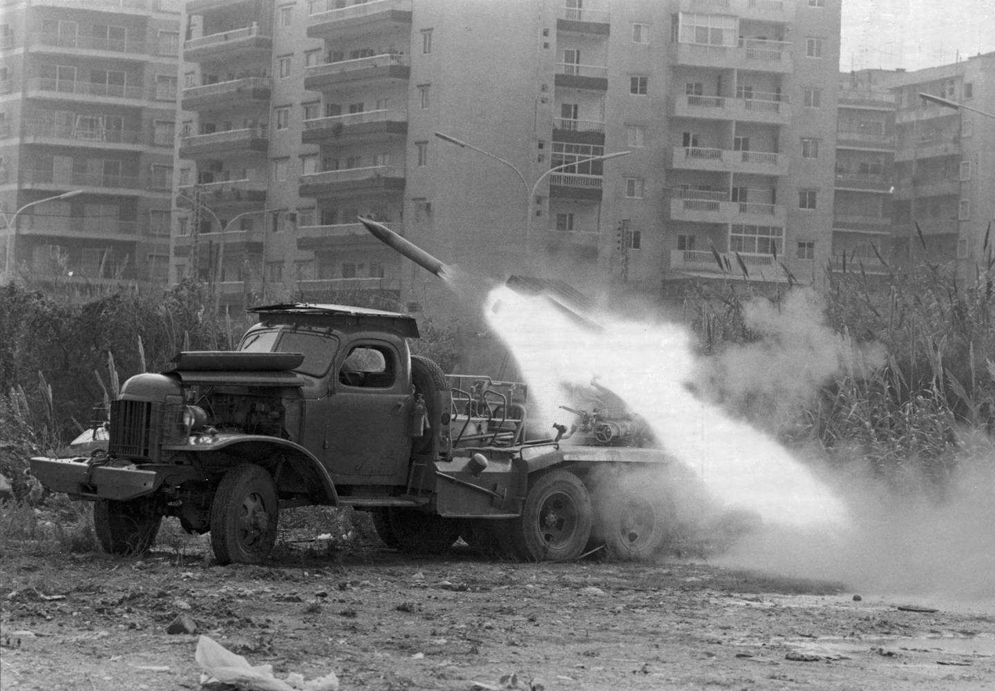 A katyusha rocket is fired from the back of an army truck into an apartment complex during the Lebanese Civil War, Lebanon, probably 1975. The war, which lasted until 1990, was fought between a bewildering array of sectarian, ideological, and foreign armed factions in continuously shifting alliances. Most prominent were the rightist Maronite Christian Phalangists, the secular Palestinian PLO, the Israelis, the Syrians, the Druze, the Shiite Amal, and Hezbollah. (Photo by Express/Getty Images)