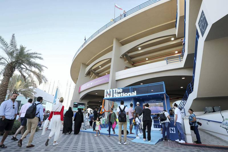 Abu Dhabi, United Arab Emirates - Reporter: Jon Turner: Tennis fans head in to watch the third place play-off between Novak Djokovic v Karen Khachanov at the Mubadala World Tennis Championship. Saturday, December 21st, 2019. Zayed Sports City, Abu Dhabi. Chris Whiteoak / The National