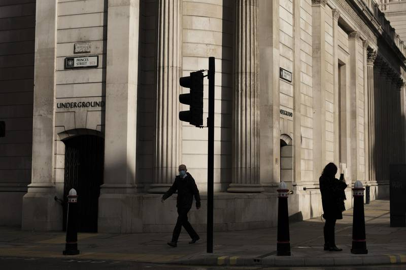 A pedestrian walks past the Bank of England (BOE) in the City of London, U.K., on Monday, Nov. 2, 2020. U.K. Prime Minister Boris Johnson, who on Saturday announced England will enter partial lockdown on Nov. 5, will on Monday try to fend off a looming rebellion from members of his Conservative Party by trying to reassure them the measures will only last four weeks. Photographer: Jason Alden/Bloomberg