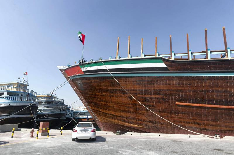 DUBAI, UNITED ARAB EMIRATES. 28 JANUARY 2021. The Obaid, officially the worlds biggest Arabic Wooden Dhow as awarded by the Guiness Book of Records loading cargo bound for Yemen in Dubai port after returning from her maiden voyage also to Yemen to deliver 600+ cars. (Photo: Antonie Robertson/The National) Journalist: Kelly Clarke. Section: National.