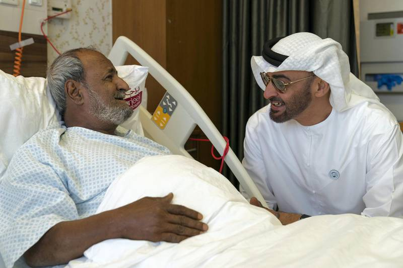 ABU DHABI, UNITED ARAB EMIRATES -  March 11, 2018: HH Sheikh Mohamed bin Zayed Al Nahyan, Crown Prince of Abu Dhabi and Deputy Supreme Commander of the UAE Armed Forces (R), visits Fadel Mahmoud Saleh (L), who is in Abu Dhabi receiving medical assistance at Burjeel Hospital.  ( Ryan Carter for the Crown Prince Court - Abu Dhabi ) ---