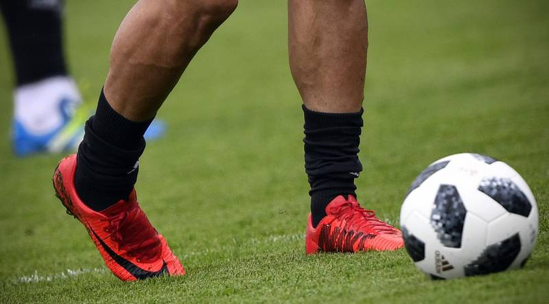 A picture taken on June 12, 2018 shows Nike football shoes of Iran's forward Mehdi Taromi during a training session in Bakovka, outside Moscow, ahead of the Russia 2018 World Cup football tournament. The American equipment manufacturer Nike confirmed on June 11, 2018 it had stopped supplying Iran's football team with boots ahead of the World Cup due to sanctions. A statement from Nike said the company was forbidden from supplying kit to the Iranian team as it prepares for its opening World Cup game. / AFP / Alexander NEMENOV