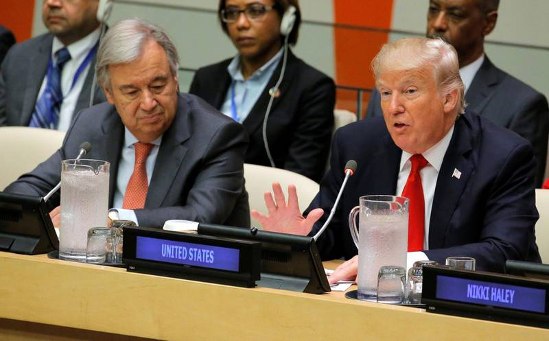 FILE PHOTO: U.N. Secretary General Antonio Guterres (L) watches as U.S. President Donald Trump speaks during a session on reforming the United Nations at U.N. Headquarters in New York, U.S., September 18, 2017. REUTERS/Lucas Jackson/File Photo