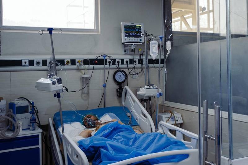 January 15th, 2019 - Kabul, Kabul, Afghanistan: Tooryalai Lal Mohammad, 25, lays in a hospital bed in the Wazir Akbar Khan public hospital. He was wounded when an explosion went off outside of Green Village. He has wounds on his arms, legs, chest and back. Doctors are still unable to fully diagnose his wounds has they do not have a portable x-ray machine and Tooryalai could not be transported to the machine.The attack on the Green Village, a compound in Kabul that houses foreign workers and NGO's, initially killed 9 and wounded over 120 Afghans who lived in the vicinity. There was also extensive property damage to the surrounding homes and shops. Ivan Flores/The National