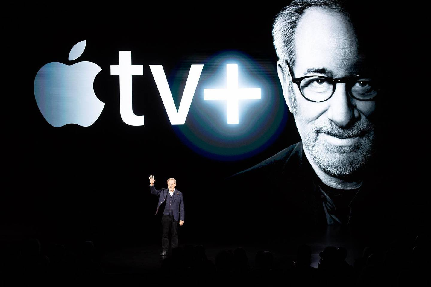 """(FILES) In this file photo taken on March 25, 2019 Director Steven Spielberg speaks during an event launching Apple tv+ at Apple headquarters in Cupertino, California. It may already have Oscars under its belt, but Netflix's acceptance by the Academy of Motion Picture Arts and Sciences hangs in the balance. The prestigious body is set to reexamine whether the streaming giant will remain eligible for such awards, despite a warning from the US Justice Department that could violate antitrust laws. Film director Steven Spielberg has suggested that Netflix films should not be eligible for Oscars, but instead for Emmy Awards handed to the stars and creators of television shows. """"Once you commit to a television format, you're a TV movie,"""" said Spielberg, who is set to work with new streaming platform Apple TV+.   / AFP / NOAH BERGER"""
