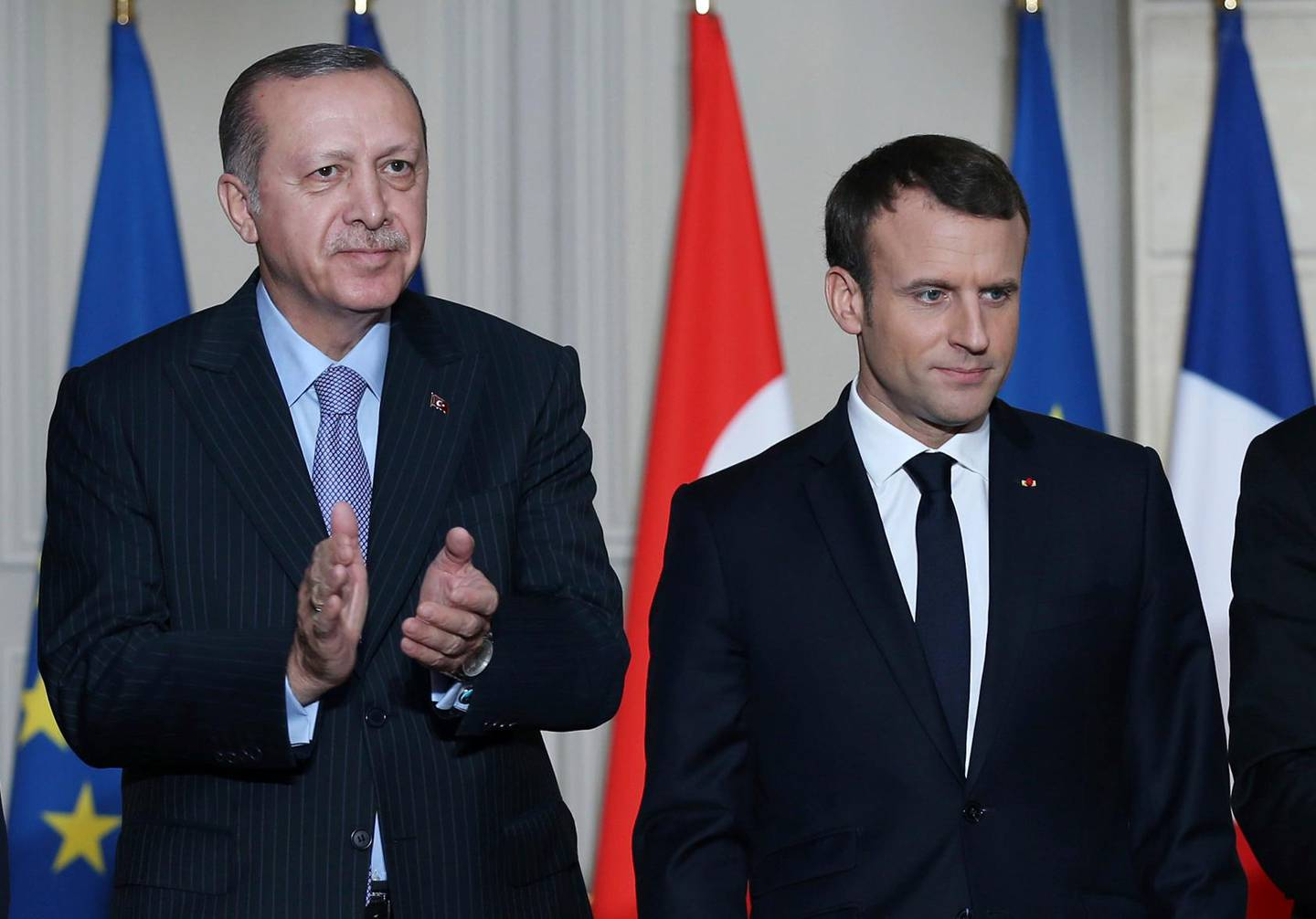 French President Emmanuel Macron, right, and Turkish President Recep Tayyip Erdogan stand during a signing ceremony at the Elysee Palace in Paris, Friday, Jan. 5, 2018.  Erdogan is in Paris for talks with Macron amid protests over press freedom and the deteriorating state of human rights in Turkey. (Yasin Bulbul/Pool Photo via AP)