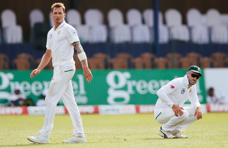 Cricket - Sri Lanka v South Africa - Second Test Match - Colombo, Sri Lanka - July 20, 2018 - South Africa's captain Faf du Plessis (R) reacts next to Dale Steyn. REUTERS/Dinuka Liyanawatte