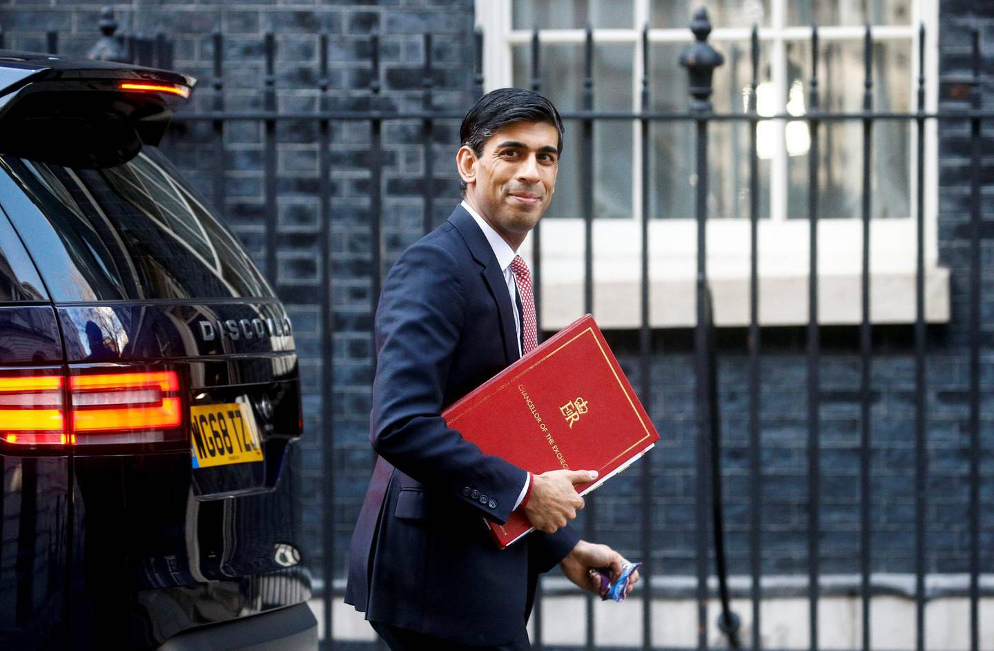 Britain's Chancellor of the Exchequer Rishi Sunak walks at Downing Street in London, Britain March 16, 2020. REUTERS/Henry Nicholls