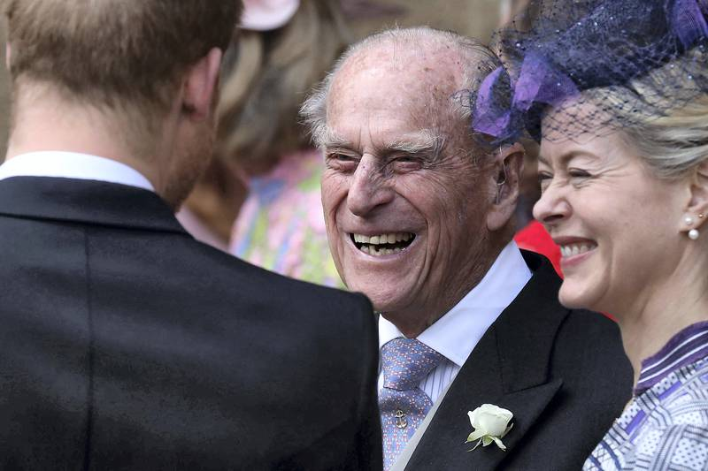 Britain's Prince Philip, Duke of Edinburgh reacts as he talks with Britain's Prince Harry, Duke of Sussex as they leave St George's Chapel in Windsor Castle, Windsor, west of London, on May 18, 2019, after the wedding of Lady Gabriella Windsor and Thomas Kingston. - Lady Gabriella, is the daughter of Prince and Princess Michael of Kent. Prince Michael, is the Queen Elizabeth II's cousin. (Photo by Steve Parsons / POOL / AFP)