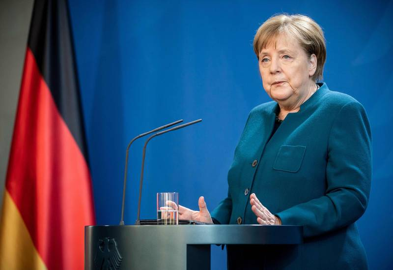 German Chancellor Angela Merkel makes a press statement on the spread of the new coronavirus COVID-19 at the Chancellery, in Berlin on March 22, 2020. German Chancellor Angela Merkel is going in to quarantine after meeting virus-infected doctor according to her spokesman on March 22, 2020. / AFP / POOL / Michael Kappeler