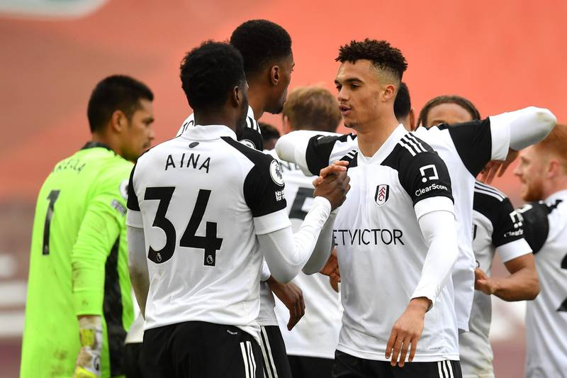 LIVERPOOL, ENGLAND - MARCH 07: Antonee Robinson of Fulham celebrates victory with team mate Ola Aina following the Premier League match between Liverpool and Fulham at Anfield on March 07, 2021 in Liverpool, England. Sporting stadiums around the UK remain under strict restrictions due to the Coronavirus Pandemic as Government social distancing laws prohibit fans inside venues resulting in games being played behind closed doors. (Photo by Paul Ellis - Pool/Getty Images)