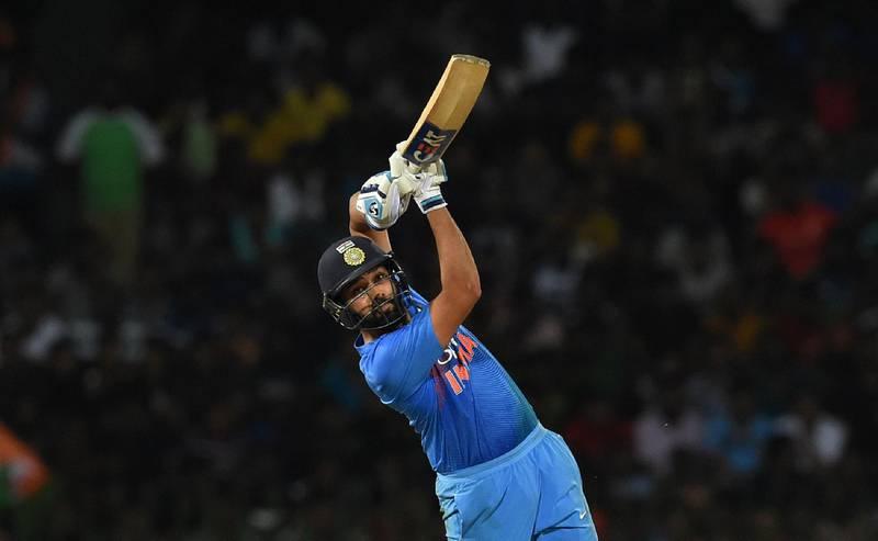 Indian captain Rohit Sharma plays a shot during the final Twenty20 international cricket match between Bangladesh and India of the Nidahas Trophy tri-nation Twenty20 tournament at the R. Premadasa stadium in Colombo on March 18, 2018. / AFP PHOTO / Ishara S. KODIKARA