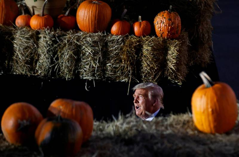 U.S. President Donald Trump is seen between pumpkins during a campaign rally at Pittsburgh-Butler Regional Airport in Butler, Pennsylvania , U.S., October 31, 2020. REUTERS/Carlos Barria     TPX IMAGES OF THE DAY