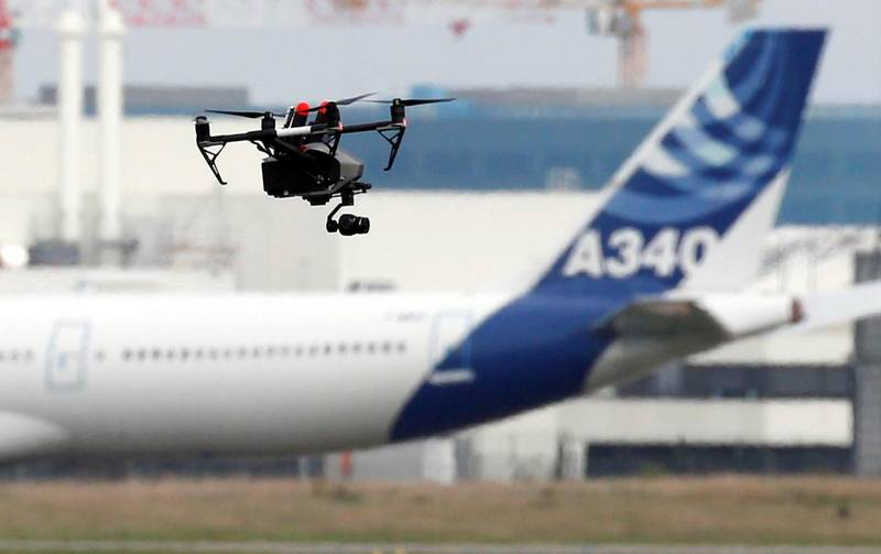 A drone flies near an Airbus A340 aircraft in Colomiers near Toulouse, France, October 19, 2017. REUTERS/Regis Duvignau