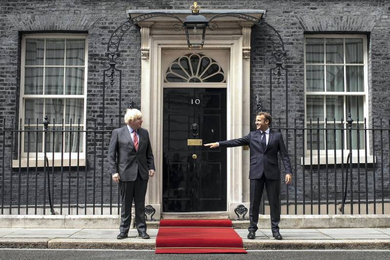 LONDON, ENGLAND - JUNE 18: Prime Minister, Boris Johnson greets French President, Emmanuel Macron while keeping at a social distance at Number 10 Downing Street on June 18, 2020 in London, England. L'Appel du 18 Juin (The Appeal of 18 June) was the speech made by Charles de Gaulle to the French in 1940 and broadcast in London by the BBC. It called for the Free French Forces to fight against German occupation. The appeal is often considered to be the origin of the French Resistance in World War II. President Macron is the first foreign dignitary to visit the UK since the Coronavirus Lockdown began. (Photo by Dan Kitwood/Getty Images)