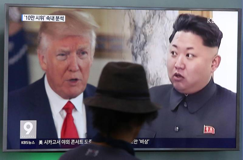 """A man watches a television screen showing President Donald Trump and North Korean leader Kim Jong Un during a news program at the Seoul Train Station in Seoul, South Korea, Thursday, Aug. 10, 2017. President Donald Trump issued a new threat to North Korea on Thursday, demanding that Kim Jong Un's government """"get their act together"""" or face extraordinary trouble. He said his previous """"fire and fury"""" warning to Pyongyang might have been too mild. (AP Photo/Ahn Young-joon)"""