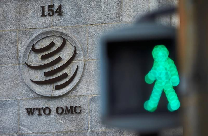 FILE PHOTO: A logo is pictured in front of the World Trade Organization (WTO) in Geneva, Switzerland, July 22, 2020. REUTERS/Denis Balibouse/File Photo