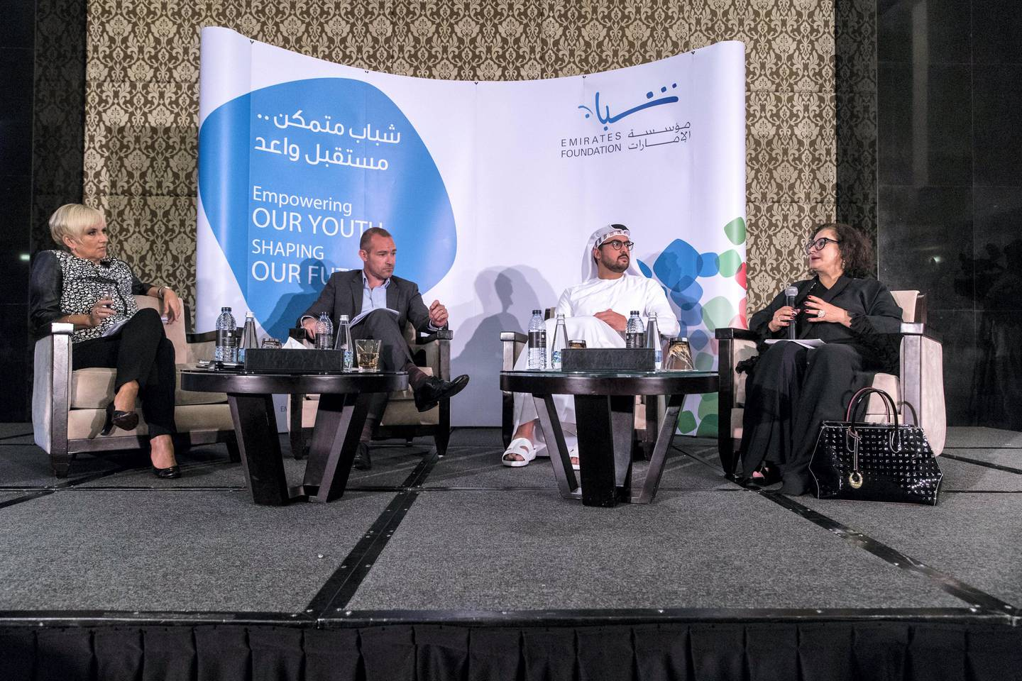 Dubai, United Arab Emirates, September 19, 2017:    Nariman Abdulla Kamber Alawadhi, chief manager at the Central Bank of the UAE, right, speaks as Clare Woodcraft-Scott, CEO of the Emirates Foundation, left to right, Andrew Woolnough VP, Corporate Communications, CEMEA Visa Middle East and Tariq Mana Saeed Al Otaiba, Sr. associate office of Strategic Affairs Crown Prince Court, Abu Dhabi listen on during a panel discussion about boosting financial literacy confidence among youth hosted by the Emirates Foundation at The Address Hotel in the Dubai Marina area of Dubai on September 19, 2017. Christopher Pike / The National  Reporter: Alice Haine Section: News