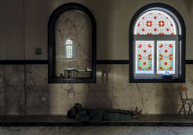 (No permission given to take this pic)   Dubai, United Arab Emirates - May 09, 2019: Standalone. A man takes rest mosque during ramadan. Thursday the 9th of May 2019 in Dubai. Chris Whiteoak / The National