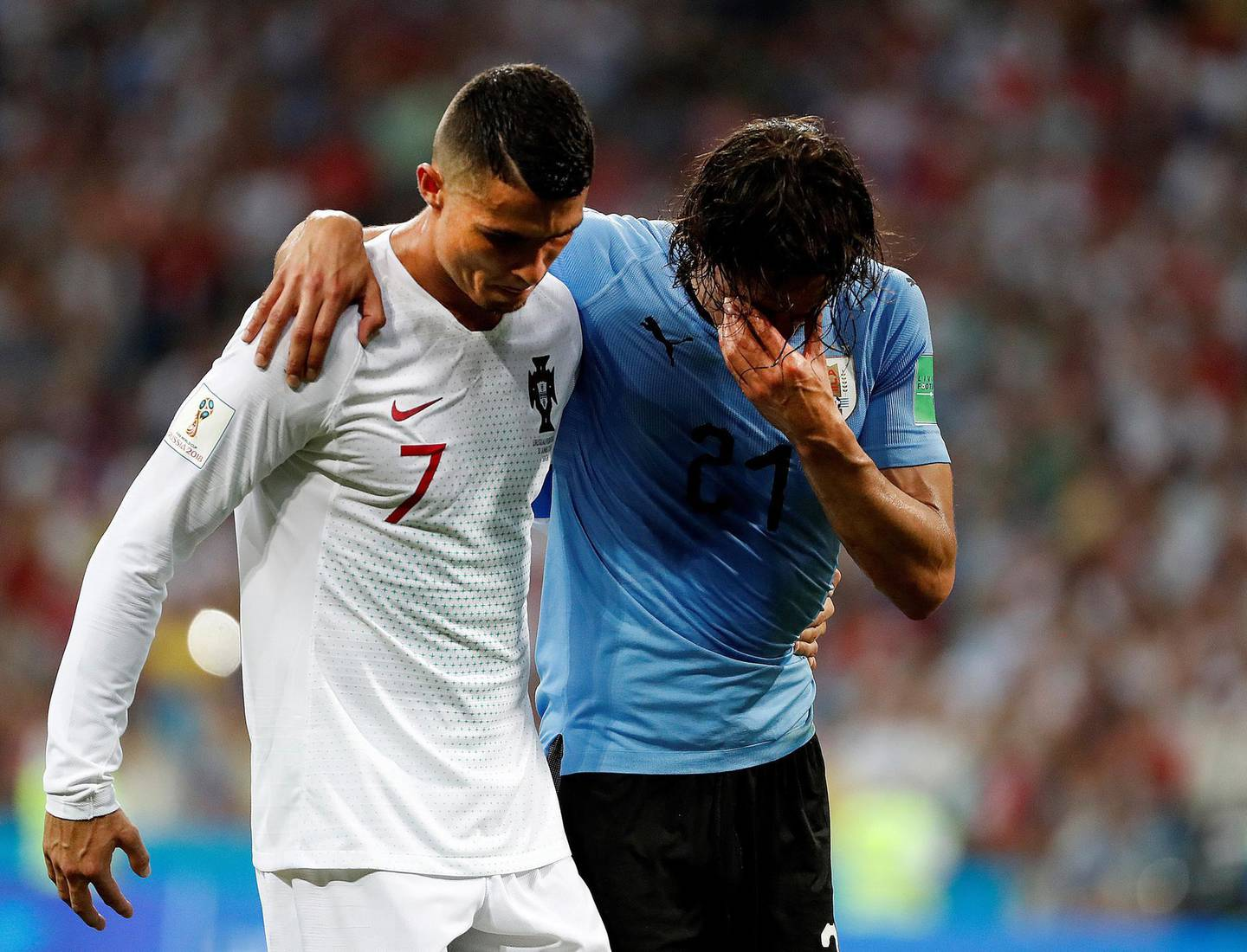 epaselect epa06853381 Portugal's Cristiano Ronaldo (L) helps Uruguay's Edinson Cavani during the FIFA World Cup 2018 round of 16 soccer match between Uruguay and Portugal in Sochi, Russia, 30 June 2018.  (RESTRICTIONS APPLY: Editorial Use Only, not used in association with any commercial entity - Images must not be used in any form of alert service or push service of any kind including via mobile alert services, downloads to mobile devices or MMS messaging - Images must appear as still images and must not emulate match action video footage - No alteration is made to, and no text or image is superimposed over, any published image which: (a) intentionally obscures or removes a sponsor identification image; or (b) adds or overlays the commercial identification of any third party which is not officially associated with the FIFA World Cup)  EPA/JUAN HERRERO EDITORIAL USE ONLY  EDITORIAL USE ONLY