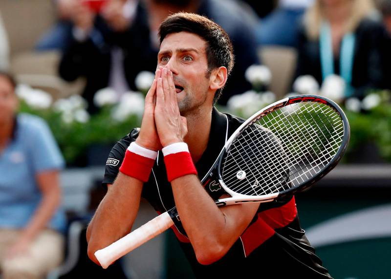 epaselect epa06787397 Novak Djokovic of Serbia reacts as he plays Marco Cecchinato of Italy during their men's quarter final match during the French Open tennis tournament at Roland Garros in Paris, France, 05 June 2018.  EPA/GUILLAUME HORCAJUELO