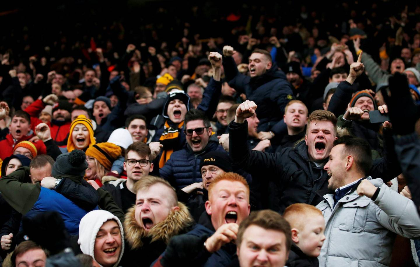 """Soccer Football - Premier League - Wolverhampton Wanderers v Leicester City - Molineux Stadium, Wolverhampton, Britain - January 19, 2019  Wolverhampton Wanderers fans celebrate after Diogo Jota (not pictured) scored their fourth goal  Action Images via Reuters/Craig Brough  EDITORIAL USE ONLY. No use with unauthorized audio, video, data, fixture lists, club/league logos or """"live"""" services. Online in-match use limited to 75 images, no video emulation. No use in betting, games or single club/league/player publications.  Please contact your account representative for further details.     TPX IMAGES OF THE DAY"""
