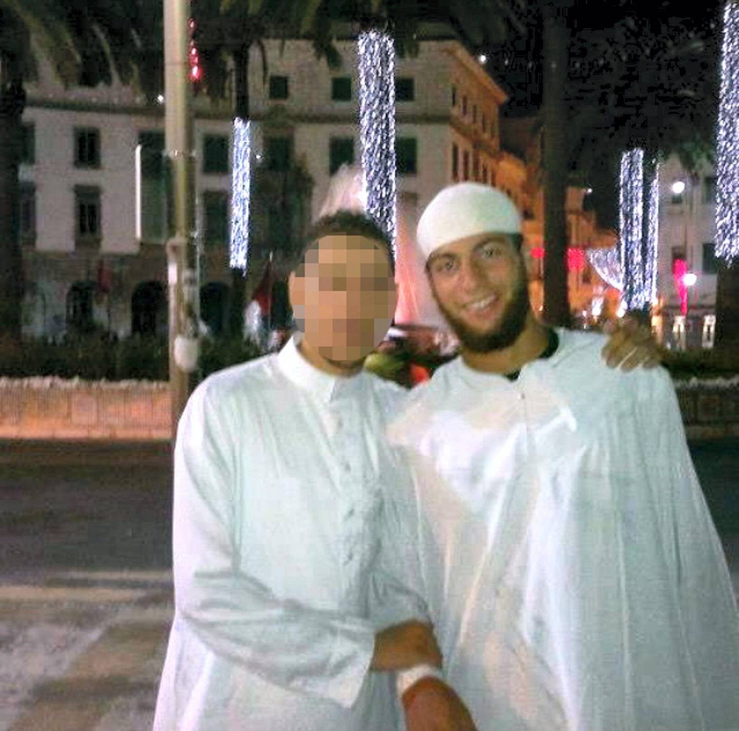 """An undated photo released by a social network shows the 25-year-old Moroccan suspect in Friday's shooting, named as Ayoub El-Khazzani (R), who was overpowered by two US servicemen and other passengers before he could kill anyone during an attack aboard an Amsterdam-Paris Thalys train on August 21, 2015. He lived in (southern) Spain in Algeciras for a year, until 2014, then he decided to move to France. Once in France he went to Syria, then returned to France, according to a Spanish anti-terror source. AFP PHOTO / SOCIAL NETWORK  = RESTRICTED TO EDITORIAL USE - MANDATORY CREDIT """"AFP PHOTO / SOCIAL NETWORK"""" - NO MARKETING NO ADVERTISING CAMPAIGNS - DISTRIBUTED AS A SERVICE TO CLIENTS = (Photo by - / - / AFP)"""