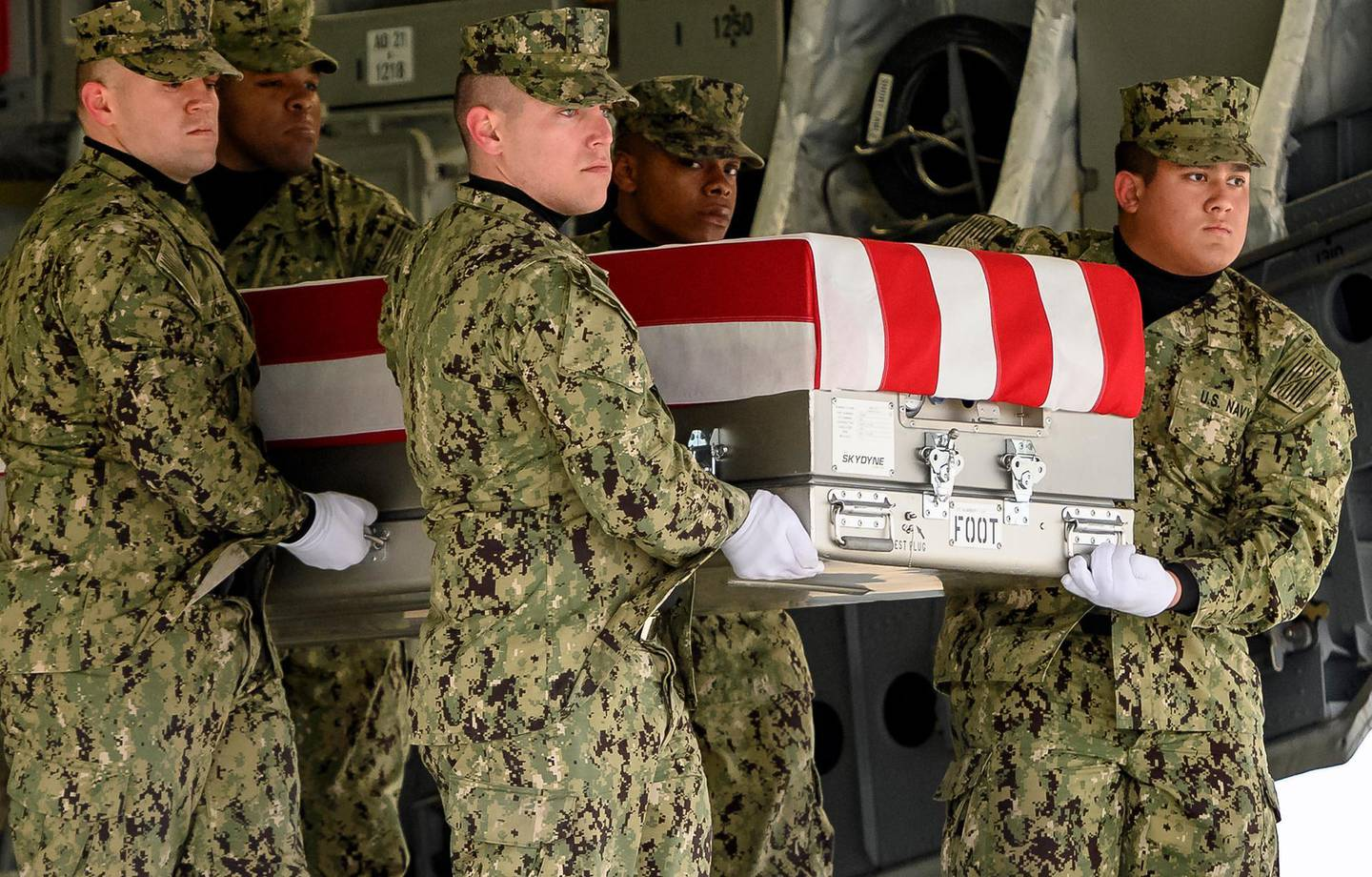 epa07301553 A US Navy carry team carries the transfer case of former Navy SEAL and Department of Defense civilian Scott A. Wirtz to the transfer vehicle during the dignified transfer at Dover Air Force Base in Dover, Delaware, USA, on 19 January 2019. Wirtz was one of four Americans killed during a suicide bombing in the northern Syrian city of Manbij.  EPA/Scott Serio