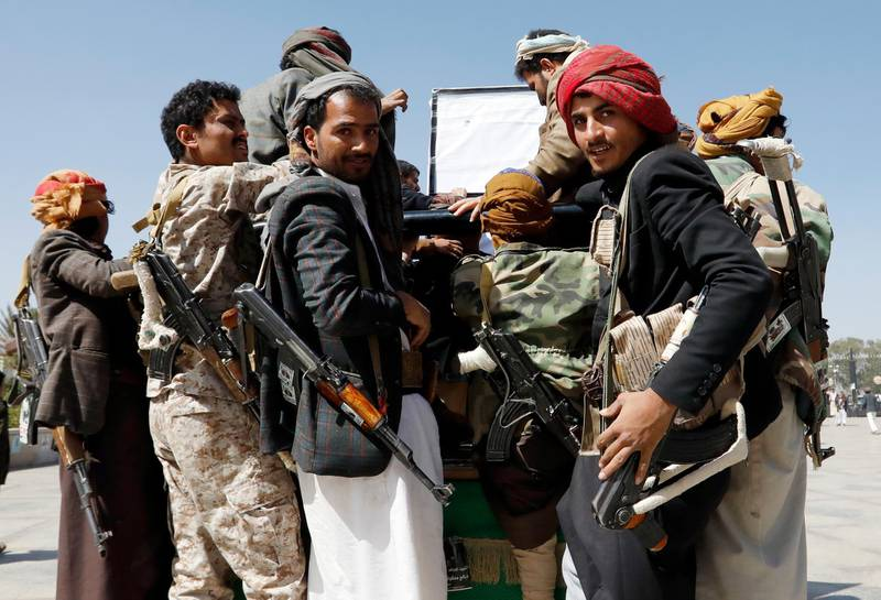 epa09042523 Armed Houthi fighters ride a vehicle as they attend a funeral procession for slain Houthi fighters in Sana'a, Yemen, 28 February 2021. The Houthi military spokesman, Yahya Sarea, has threatened more attacks against Saudi Arabia, which leads a military coalition involved in the escalating conflict in Yemen, a day after the Houthis carried out attacks with 15 drones and a ballistic missile against the Saudi capital Riyadh and the south of the kingdom.  EPA/YAHYA ARHAB