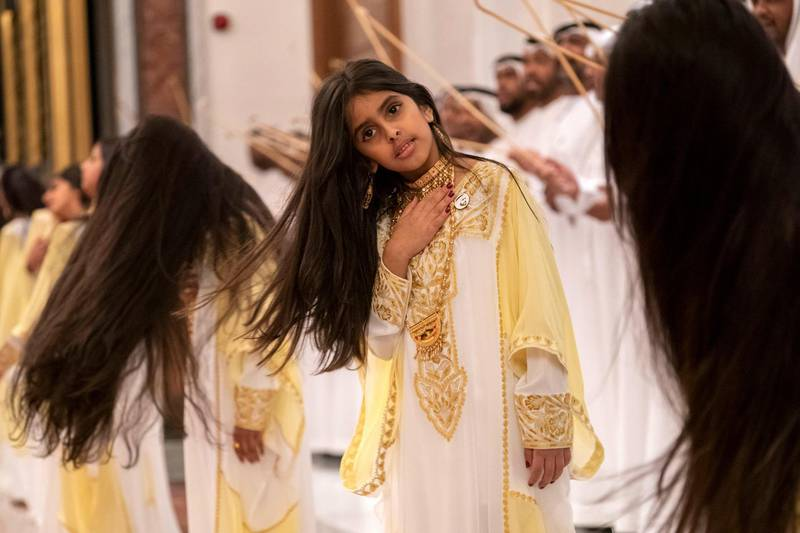 ABU DHABI, UNITED ARAB EMIRATES - February 3, 2019: Day one of the UAE papal visit - A children dance during arrival of His Holiness Pope Francis, Head of the Catholic Church (not shown), and His Eminence Dr Ahmad Al Tayyeb, Grand Imam of the Al Azhar Al Sharif (not shown), at the Presidential Airport.  ( Ryan Carter / Ministry of Presidential Affairs ) ---